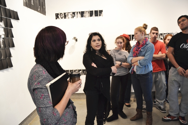 Cecilia Mandrile reflecting on her work to her students in Seton Gallery at the University of New Haven